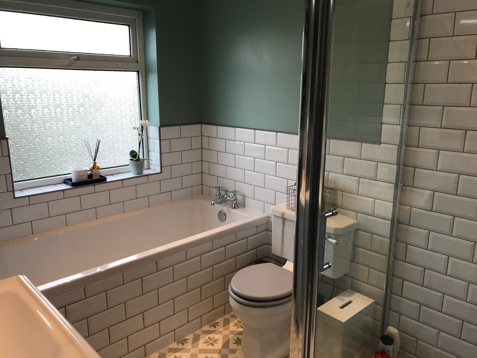 Traditional Bathroom with White Metro Tiles and Patterned ...