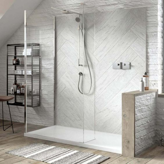 walk in shower with built out half height wall and hinged shower screen